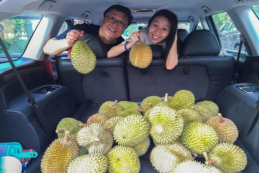 Crowds have been gathering at Delight Fruit Trading where the durians have been going for $1 each and the premium Mao Shan Wang variety for $5. Mr Peter Loh, with his daughter Natasha, celebrated Father's Day last weekend by organising a durian gathe