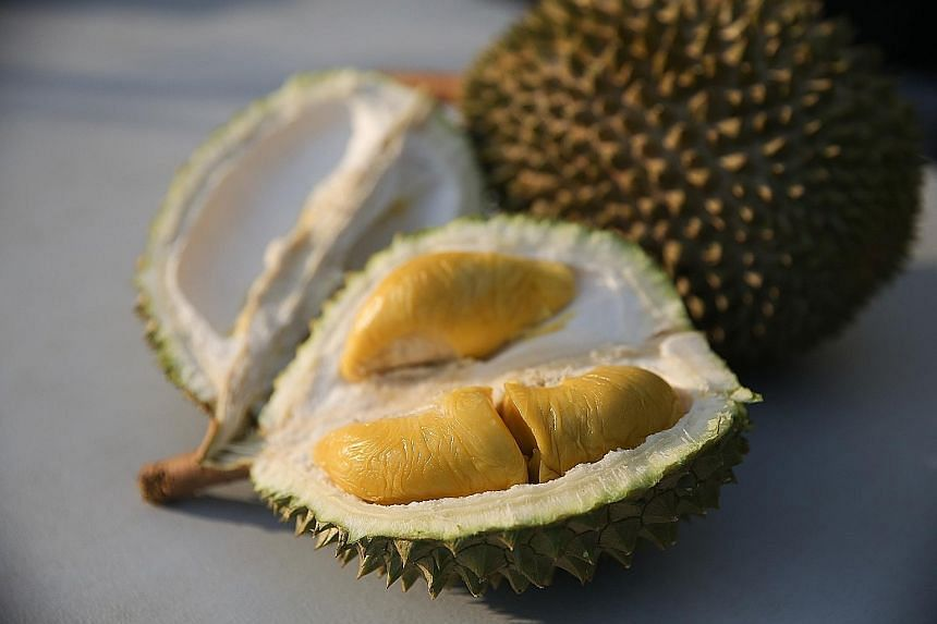 Pesticide-free durians from 818 Durians & Pastries (top) and the $5 durians from Delight Fruit Trading (above).