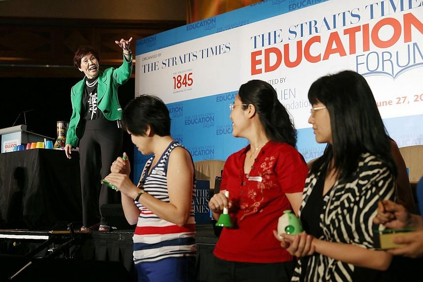 Mrs Carmee Lim, mentor principal of MindChamps Holdings, showing participants the importance of music, movement and dance in early childhood development at The Straits Times Education Forum yesterday.