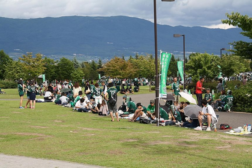 Yamaga fans paint the town green as they gather four hours before kick-off at the Alwin Stadium. Green banners are another sign of support while the local pubs serve green beer too.