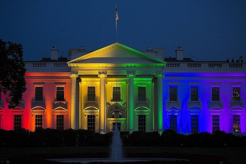 The White House illuminated at dusk in rainbow-coloured lights, the symbolic colours of gay pride, in Washington, DC on Friday.
