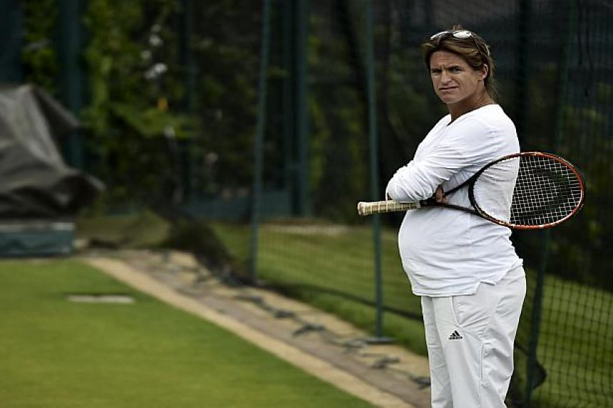 Pregnant Amelie Mauresmo watches Andy Murray during practice in London on June 27, 2015.