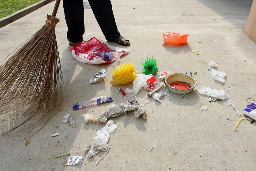 A cleaner sweeps up litter at Hougang Ave 1 Blk 126. Many Singaporeans have the perception that keeping the environment clean is the job of the cleaners only. PHOTO: ST FILE