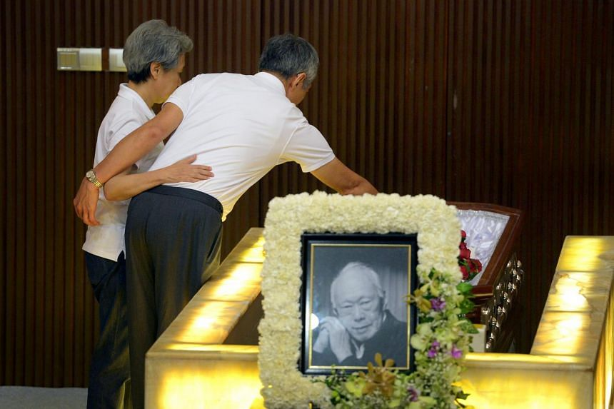 Prime Minister Lee Hsien Loong and his wife, Ho Ching, pay their final respects to Mr Lee Kuan Yew at the Mandai Crematorium on March 29, 2015. PM Lee gave the first eulogy at the service in Mandai, where he spoke about his father as head of the fami
