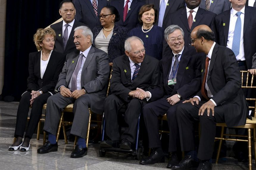 (Front row, from left) Switzerland's Finance Minister Eveline Widmer-Schlumpf, Saudi Arabia's Finance Minister Abdulaziz Al-Assaf, Germany's Finance Minister Wolfgang Schaeuble, People's Bank of China Governor Zhou Xiaochuan and Singapore's Finance M