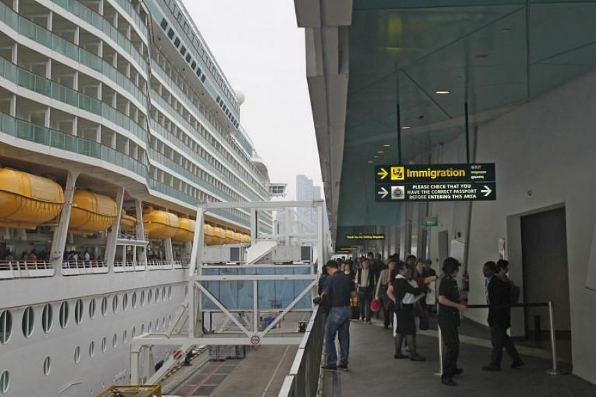 Travelers disembarking from the Royal Caribbean cruise ship towards immigrations via a link bridge on Jan 23, 2014. Royal Caribbean International is intent on making a big splash in the local cruise holiday market with its first year-long deployment