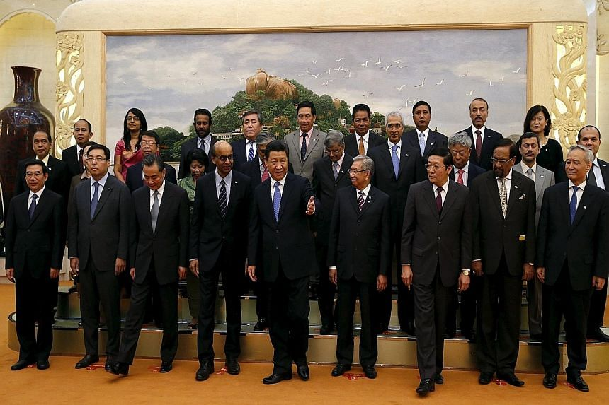 Chinese President Xi Jinping (centre) with guests, including Singapore's Deputy Prime Minister Tharman Shanmugaratnam (front row, fourth from left), at the Asian Infrastructure Investment Bank launch ceremony in Beijing last October. China is expecte