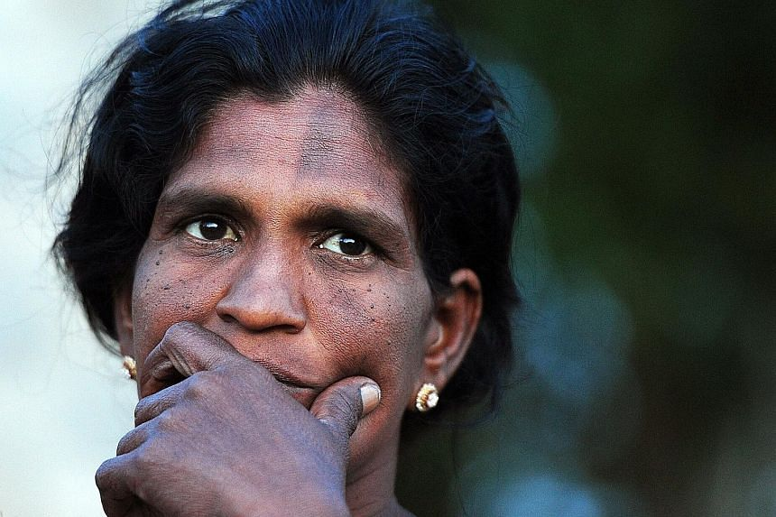 Ms Evin Selvy, who struggles to feed her family on her wages as a farm labourer, hopes the new government will improve life for her three daughters. Her husband was killed just before the separatist war ended in 2009.
