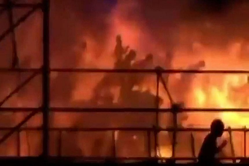 Video footage shows revellers being engulfed in flames after coloured powder that was sprayed on them ignited.