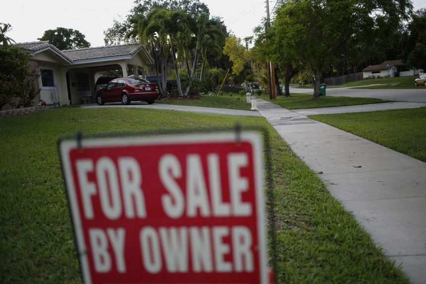 """A """"For Sale By Owner"""" sign stands in front of a house in Miami, Florida, on Monday, June 15, 2015."""