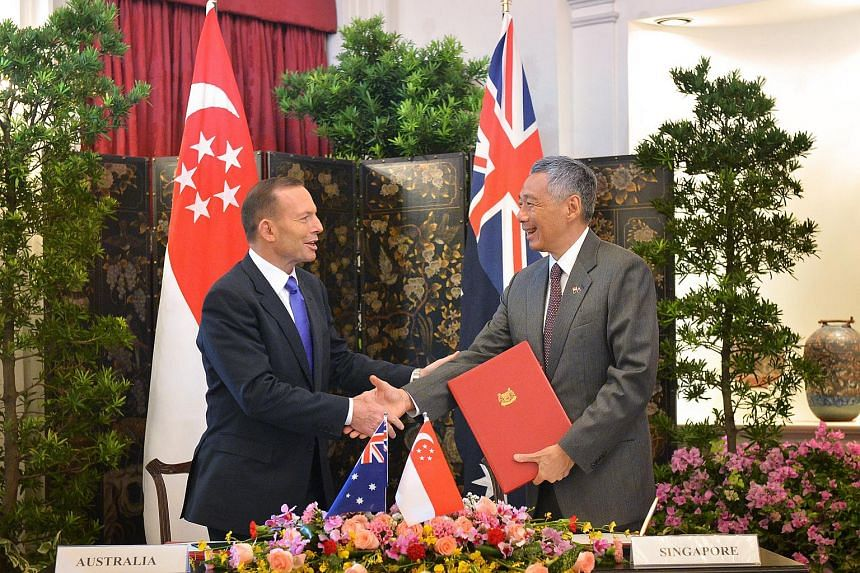 Australia Prime Minister Tony Abbott (left) and Singapore Prime Minister Lee Hsien Loong at the Istana on June 29, 2015.