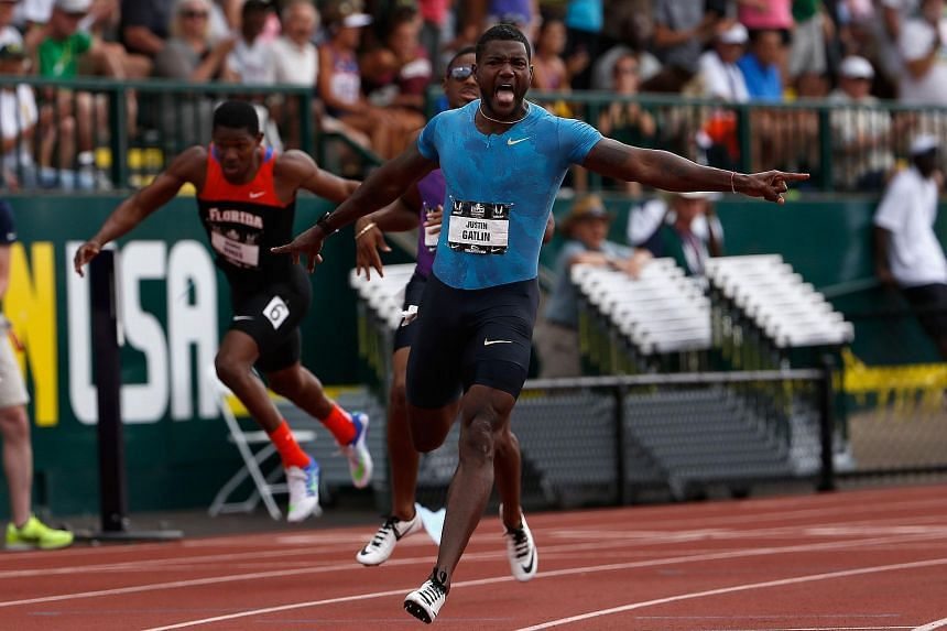 Justin Gatlin celebrates after crossing the finish line to win the men's 200m race at the 2015 USA Outdoor Track & Field Championships in Oregon on June 28, 2015.