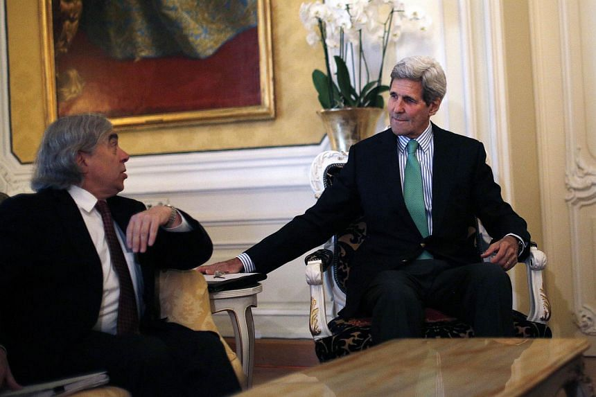 US Secretary of State John Kerry (Right) talks with US Secretary of Energy Ernest Moniz (Left) during a meeting at a hotel in Vienna, Austria on June 29, 2015.