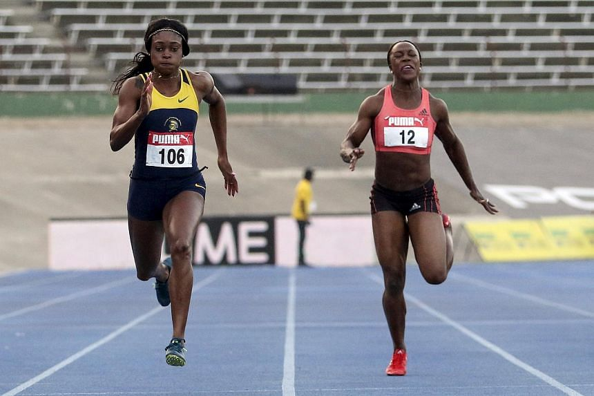 Elaine Thompson (left) runs to win the women's 200m finals against Veronica Campbell Brown (right) in the National Trials at National Stadium in Kingston, Jamaica on June 28, 2015.
