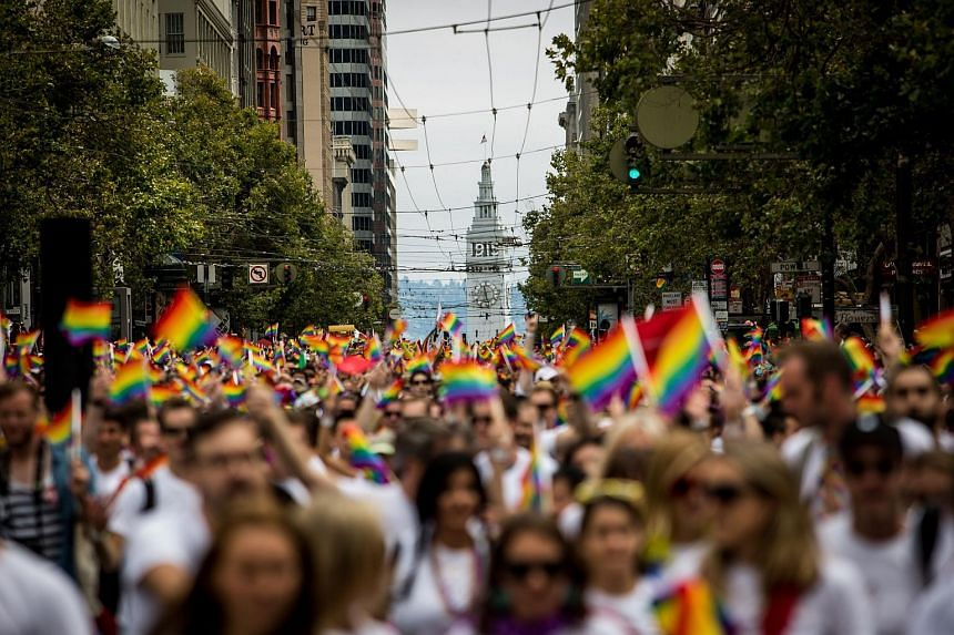 San Francisco's Ferry Builiding is seen behind marchers in the San Francisco Gay Pride Parade on June 28, 2015. The 2015 pride parade comes two days after the US Supreme Court's landmark decision to legalize same-sex marriage in all 50 states.