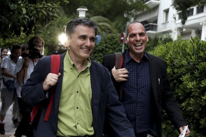 Greek Finance Minister Yanis Varoufakis and head negotiator with Greece's lenders Euclid Tsakalotos (left) arrive at Prime Minister Alexis Tsipras' office in Athens, Greece on June 28, 2015.