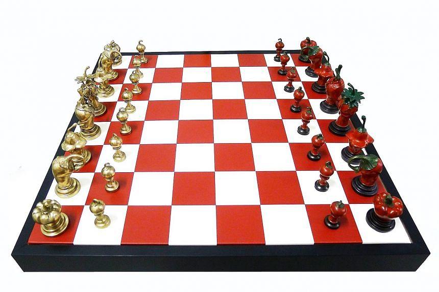 Kumari Nahappan's chilli chessboard artwork, Moves On Spice.