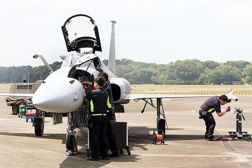 Servicemen of 144 Squadron performing an arming drill for the F-5S/T fighter aircraft. The squadron won the Best Fighter Squadron award for the fourth time, ousting its more modern F-15 and F-16 counterparts. The RSS Tenacious clinched the Best Fleet