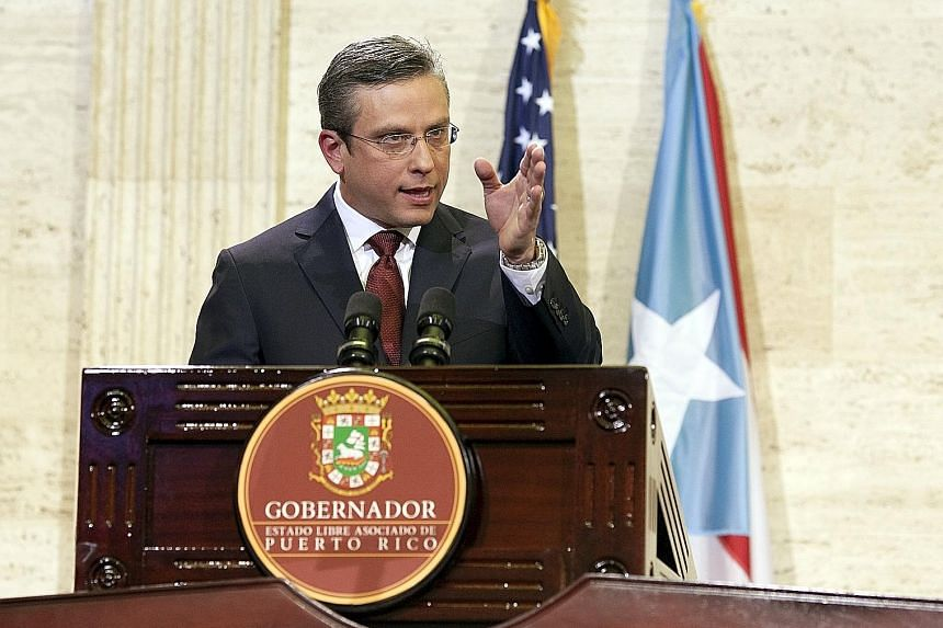 Governor Alejandro Garcia Padilla is trying to push through a Budget that will allow Puerto Rico to service its S$97 billion debt.