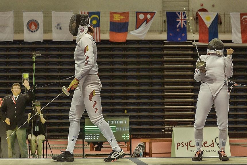 An overjoyed South Korea fencer Choi Eun Sook, after scoring the winning point against China's Sun Yujie in the women's epee team final. Her team were up 34-30 and she scored the last 11 points for victory.