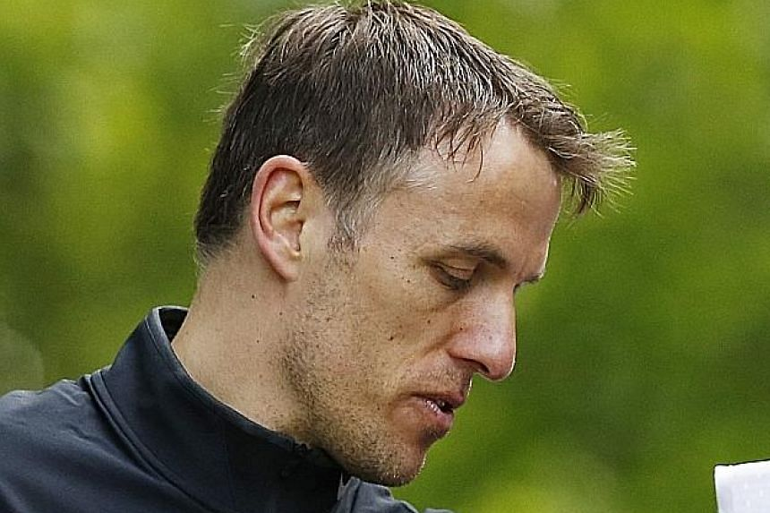 Phil Neville was a coach under David Moyes at Manchester United, but has been working as a pundit for the BBC since he was let go following the manager's sacking in May last year.