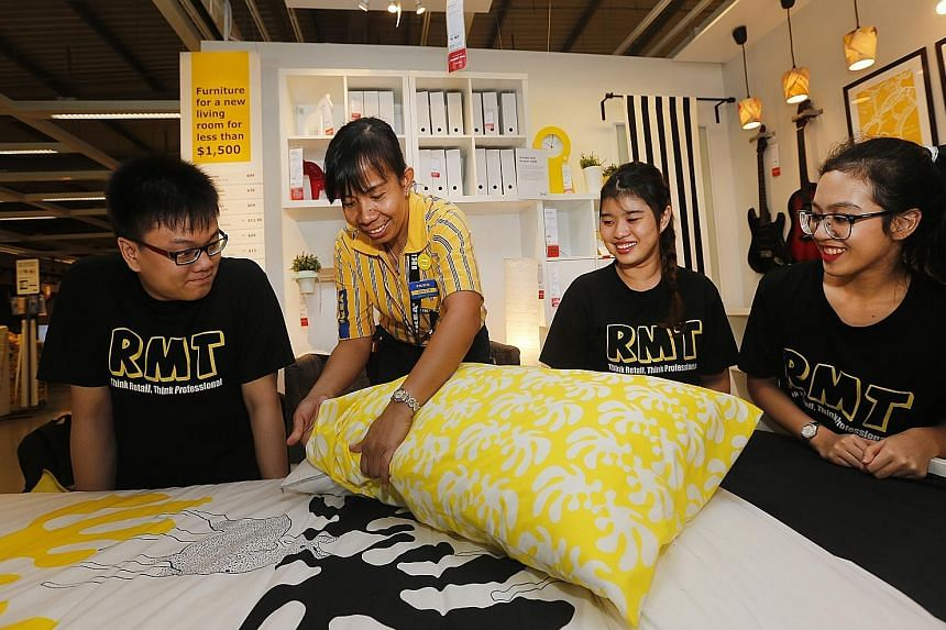 Ikea trainer Dublin Odita Par, 41, giving lessons in display to TP students (from left) Lee Chuan Jie, 21; Goh Ming Hui, 18; and Nur Atika Shir Khan, 17. The partnership will give students an inside look at one of the most successful retail operation