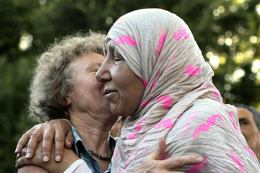 Two women embracing in front of the Mosque of Villefontaine to condemn the Saint-Quentin-Fallavier attack last Saturday.