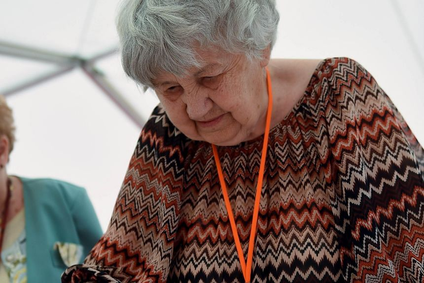Hungarian pensioner Brigitta Sinka, 87, playing simultaneous chess games in Budapest on Sunday. She beat the old record of 13,545 games set by 1920s Cuban grandmaster Jose Raul Capablanca.