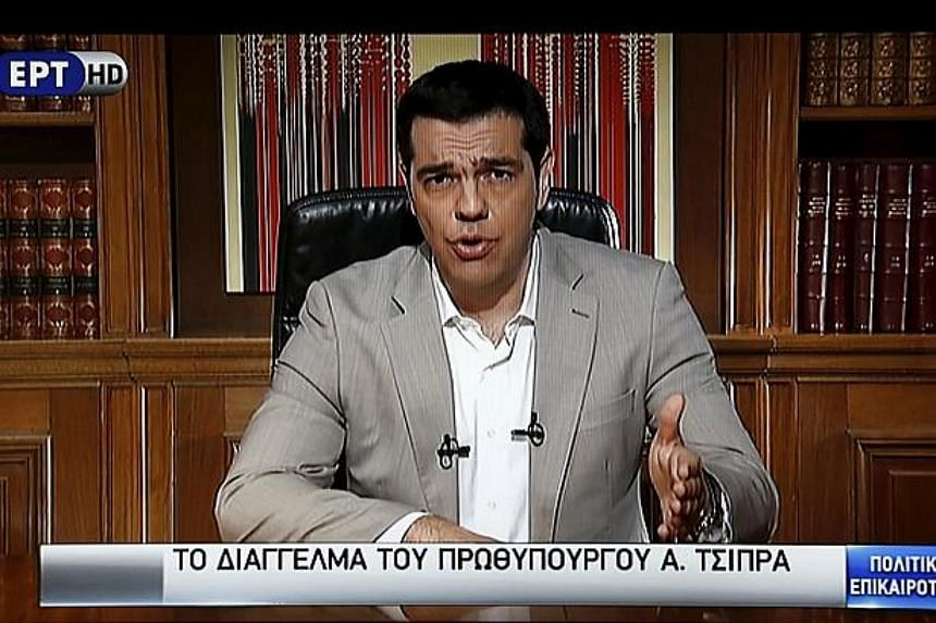 Greek Prime Minister Alexis Tsipras seen on television addressing the nation.