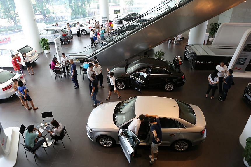 People viewing new cars at the Audi showroom.