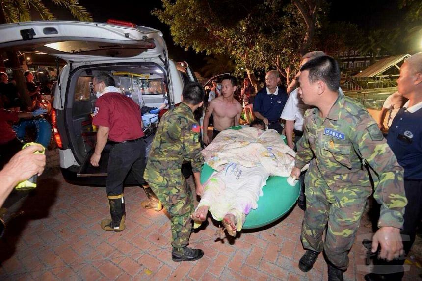 Soldiers carrying an injured person onto an ambulance at the Formosa Fun Coast water park in the Bali District of New Taipei City, northern Taiwan, on June 27, 2015.