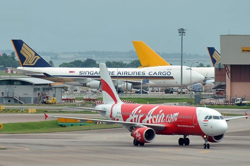 An Airbus A320 belonging to budget carrier Airbus sits on the tarmac at Changi Airport Terminal 1 on Sept 21, 2011.