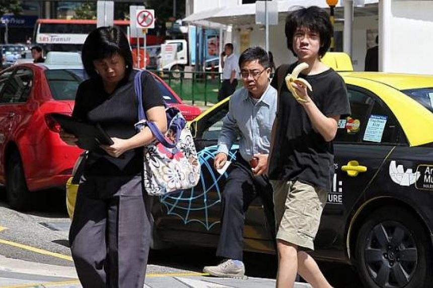 Teen blogger Amos Yee (right) arriving at the State Courts building on April 17. Complaints were filed against himfor uploading an obscene image and intending to hurt the feelings of Christians in a YouTube video.