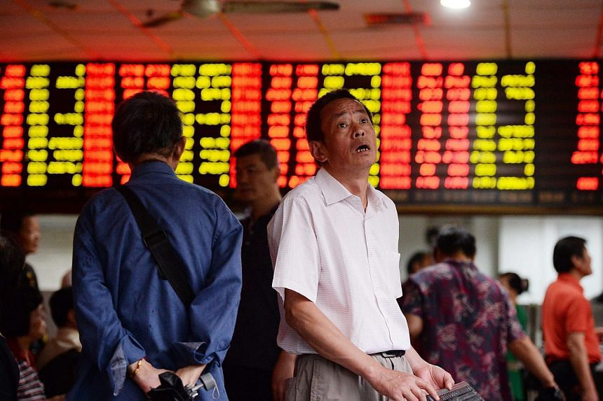 A stock investor checks prices in a brokerage house in Shanghai, China on June 29, 2015.