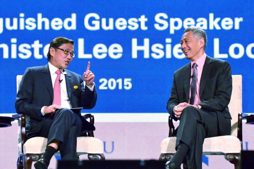 Prime Minister Lee Hsien Loong (right) at the Ho Rih Hwa Leadership in Asia Public Lecture Series, hosted by Singapore Management University chairman Ho Kwon Ping (left).