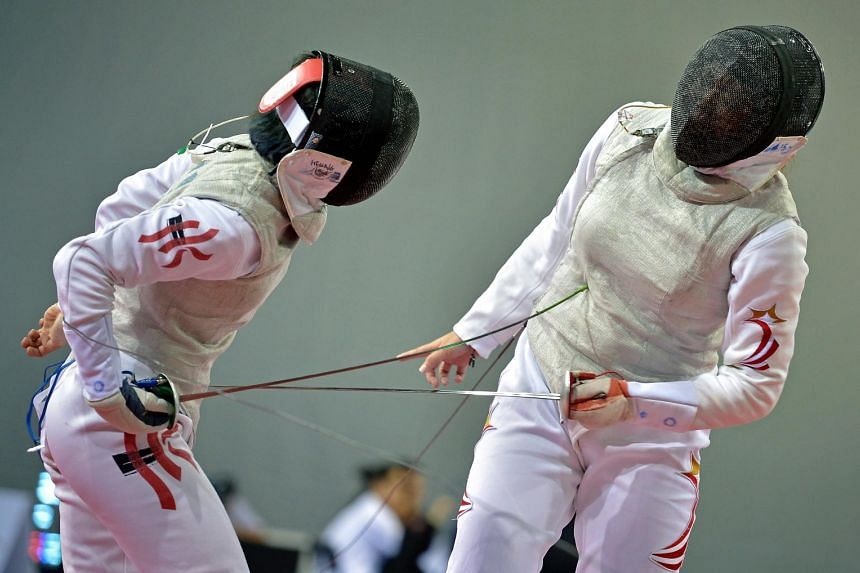 Singapore's Wang Wenying (right) losing a point to Hong Kong's Lin Po Heung during their last-16 encounter in the women's individual foil event at the Asian Fencing Championships (AFC) on June 27, 2015.
