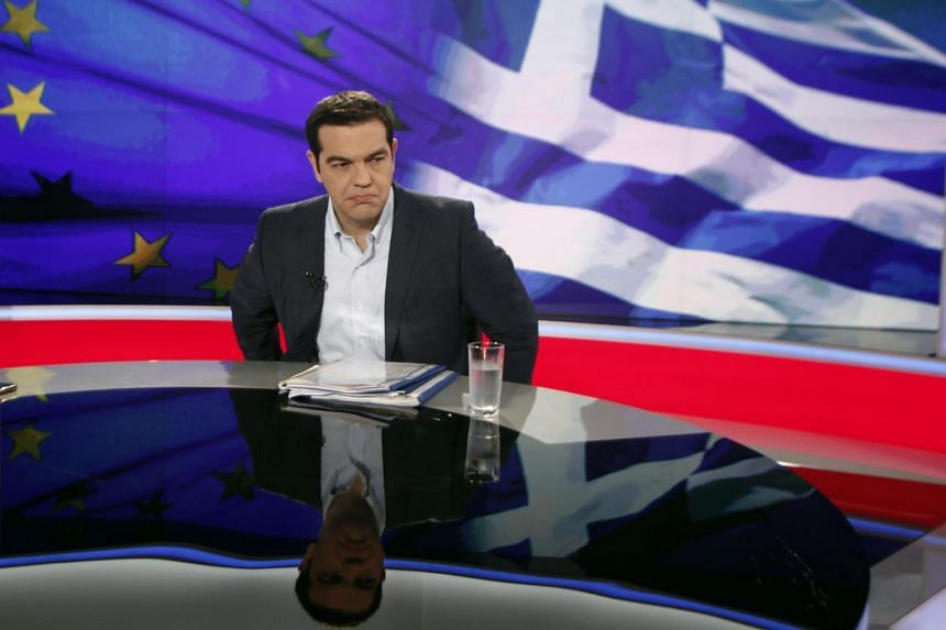 Greek Prime Minister Alexis Tsipras (right) gives an interview to Greece's state television ERT on Monday night, in Athens, Greece, on June 29, 2015.