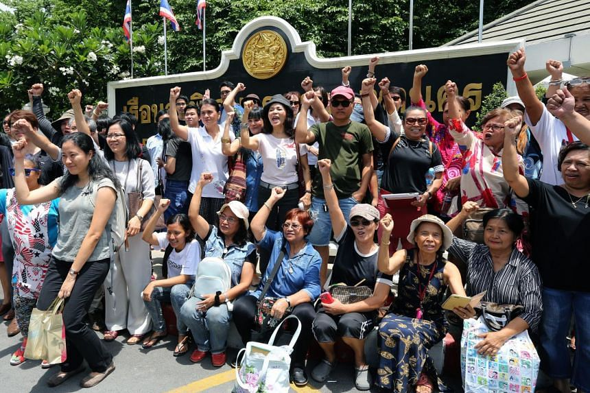Supporters of arrested Thai pro-democracy students shout slogans as they hold a rally calling to restore democracy outside the Bangkok Remand Prison in Bangkok, Thailand.