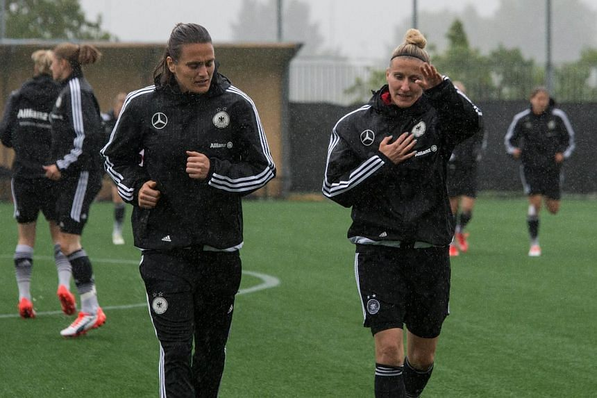 Germany's Nadine Angerer (left) and Anja Mittag take part in a training session in Montreal, Quebec on June 28, 2015, two days before a 2015 FIFA Women's World Cup semifinal match against the USA.