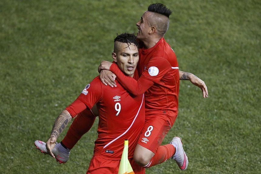 Peru's Paolo Guerrero (left) celebrating his third goal against Bolivia with teammate Christian Cueva (right).