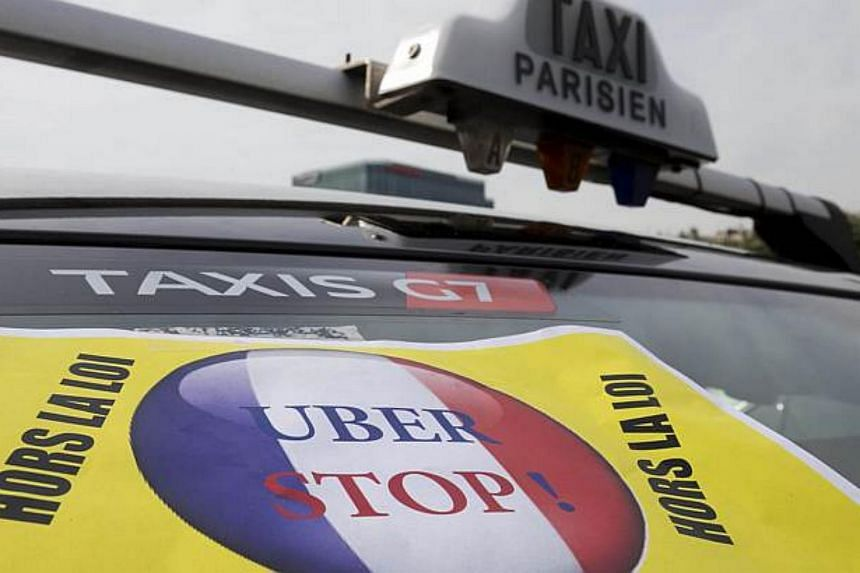 Taxis blocks the area of Porte Maillot in west Paris, on June 26, 2015, with drivers furious at what they see as unfair competition from Uber.