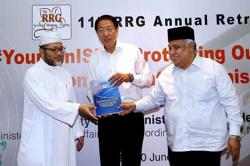 Deputy Prime Minister Teo Chee Hean (centre) during the Religious Rehabilitation Group's annual lunch retreat on June 9, 2015.