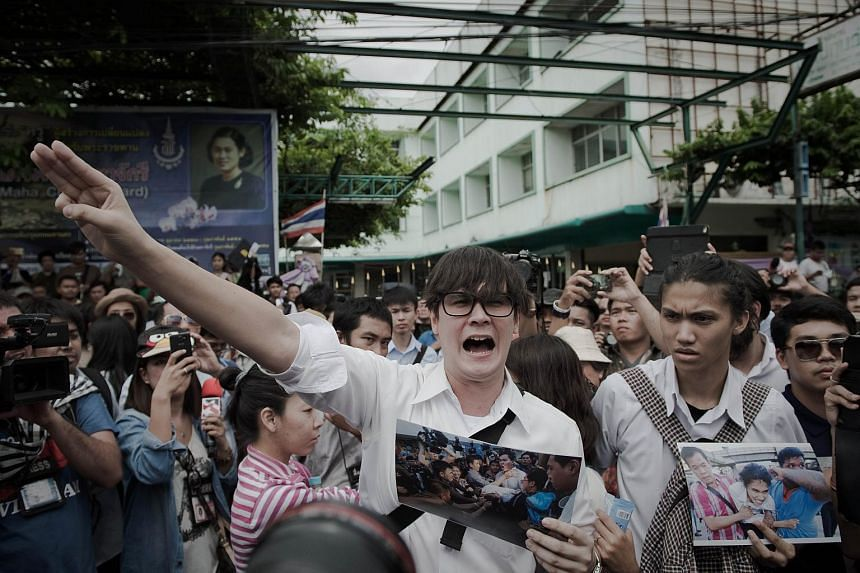 Supporters of anti-coup activists gathering outside a police station in Bangkok on June 24, 2015.