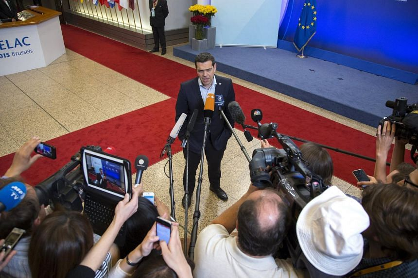 A file picture of Greek Prime Minister Alexis Tsipras talking ot the press at the European Council headquarters on June 11, 2015 PHOTO: REUTERS