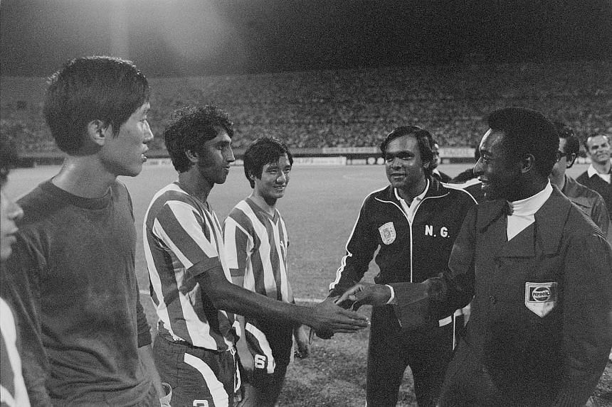 Singapore National team players with the FAS Deputy chairman Mr N Ganesan and soccer king Pele, before the match with Australia's Bayswater United at the National Stadium in 1974.