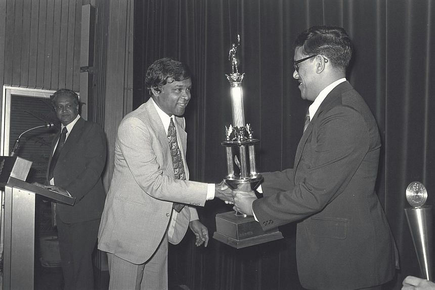 N. Ganesan (second from left), former chairman of the Football Association of Singapore (FAS) receiving a trophy from former Acting Minister for Social Affairs Ahmad Mattar (right) in 1978, on behalf of football coach, Choo Seng Quee, who was voted 1