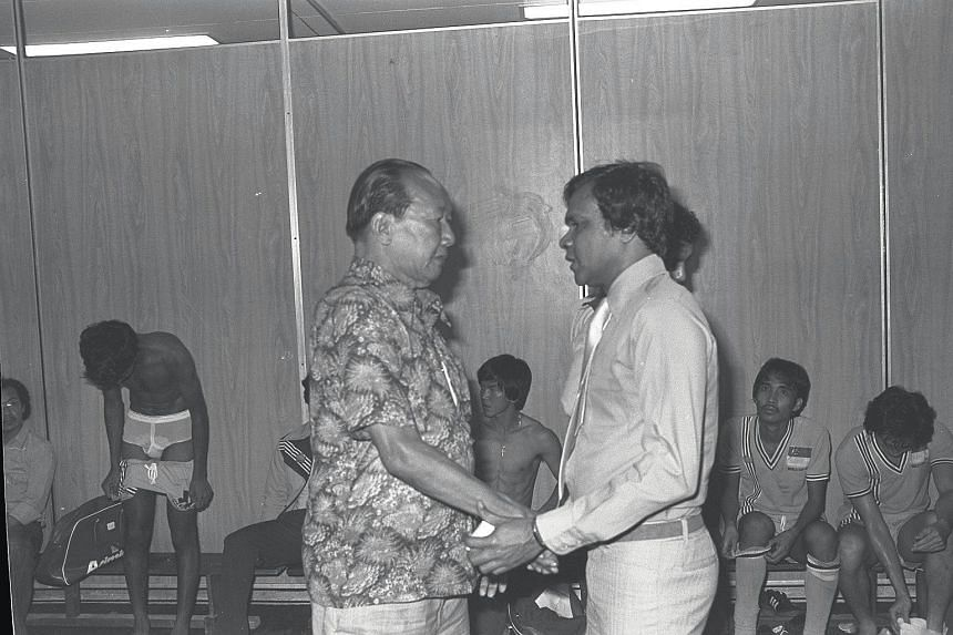 Former Singapore football coach Choo Seng Quee (left) and N. Ganesan with the Singapore team in the dressing room after a match with Hongkong in 1977.