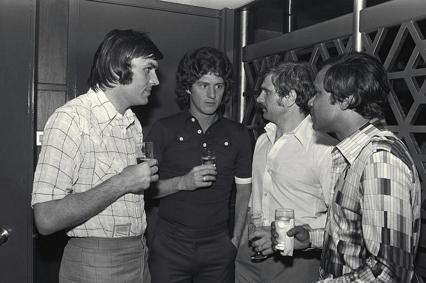 Arsenal players (from left) Jimmy Rimmer, Brian Kidd and Eddie Kelly having a chat with N. Ganesan at Ming Court Hotel, Singapore in 1975.
