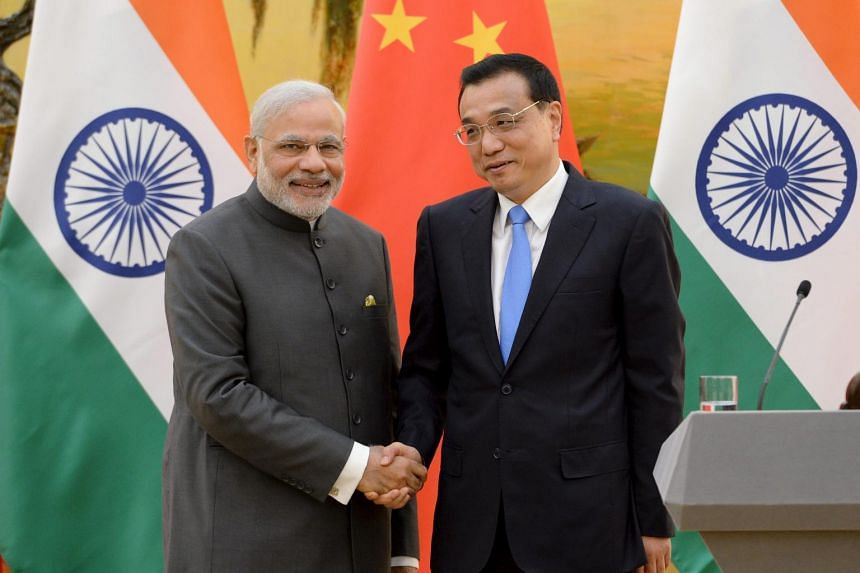 Indian Prime Minister Narendra Modi (left) shakes hands with Chinese Premier Li Keqiang during a news conference at the Great Hall of the People in Beijing, China, on May 15, 2015.