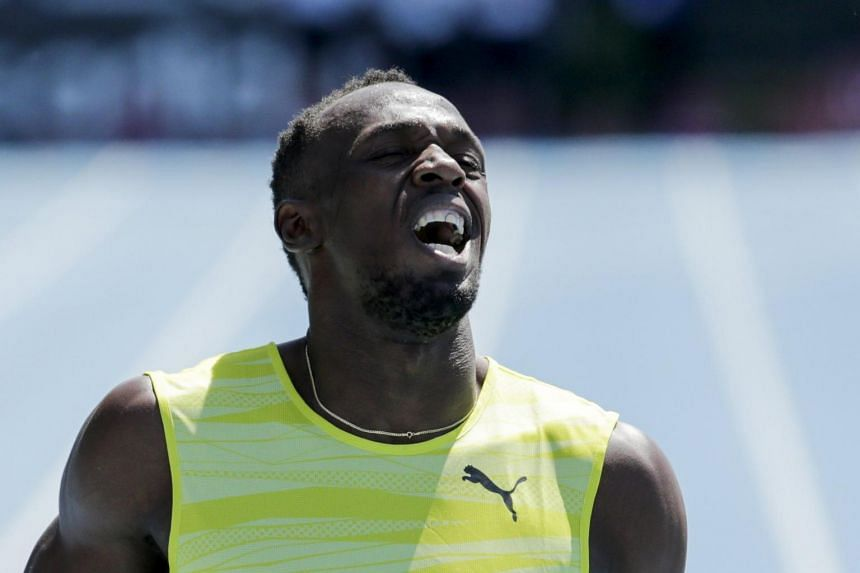 Usain Bolt of Jamaica reacts after winning the 200m at the IAAF Diamond League Grand Prix track and field competition in New York on June 13, 2015.